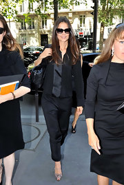 Katie Holmes looked ultra-sophisticated at the Armani Privé show in snakeskin peep-toes and a black suit.
