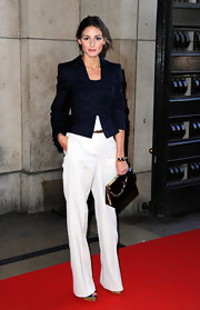 Olivia looked stylish in a buttoned pinstripe jacket and white slacks for the Armani show.