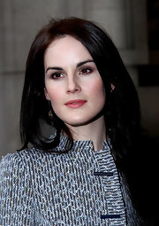 Michelle Dockery swept on soft neutral shades of shadow for the Giorgio Armani Prive fashion show in Paris.