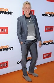 Ellen rocked a metallic gray suit over a striped polo for her casual but sophisticated red carpet look.