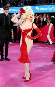 Amanda Lepore posed for the press wearing a tight color-block dress at the Annual Life Ball.