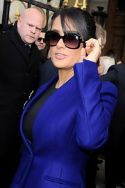 Salma Hayek shaded her eyes behind a big, bold pair of oversized frames.