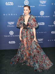 Lily Collins looked spectacular in a voluminous print gown by Elie Saab at the Art of Elysium celebration.