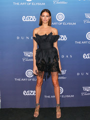 Hailey Clauson looked vampy in a sculptural trapless LBD by Dundas at the Art of Elysium celebration.