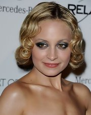 Nicole Richie knows just how to add some electricity to her look. A smoldering smoky eye with silver highlights on the inner corner does the trick!