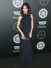 Abigail Spencer polished off her look with a metallic silver clutch.