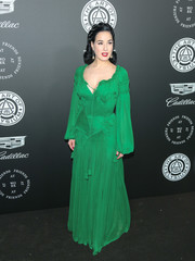 Dita Von Teese brightened up the black carpet with this emerald-green peasant gown by Jean Paul Gaultier Couture at the Art of Elysium Heaven Gala.