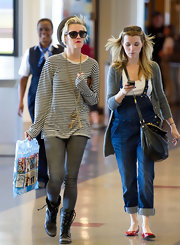 "Ashlee donned a pair of ""Twiggy"" denim leggings to the airport with her striped blouse and combat boots."