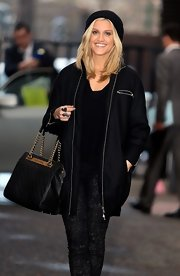 Ashley arrived at the London Studios carrying a classy Chanel handbag.