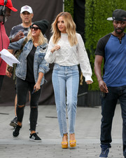 Ashley Tisdale teamed her blouse with a pair of jeans in two shades of blue.
