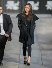 Mila Kunis made her way to the studio teetering on a pair of black platform Mary Janes.