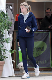 Athina kept warm in a dark blue fleece jacket while out running errands.