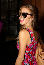 Audrina showed off a retro pair of brown rectangle shades.