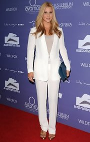 Claire Holt kept her red carpet look classic and chic by sporting a crisp white pantsuit.