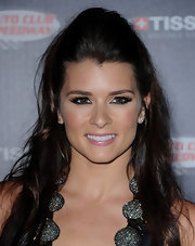 Danica Patrick wowed the crowd in a a half up half down hairstyle at the and Auto Club Speedway and Tissot event.