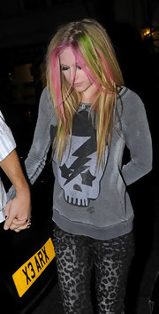 Avril opted for a faded skull sweatshirt with her leopard print pants while out with Brody.