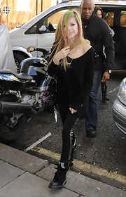 Avril wears rocker leggings with a silver stripe up the side for her hard core get up.