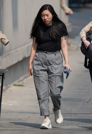 Awkwafina completed her casual ensemble with white sneakers.