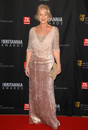 Helen Mirren wore a gorgeous pale pink velvet dress with a beaded bodice and chiffon cowl for the BAFTA Brittania Awards.