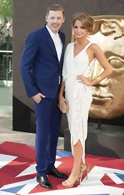 Professor Green matched his date's elegance with his blue suit during the BAFTA Awards.