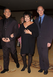 Liza Minnelli matched her black dress with a pair of suede pumps.