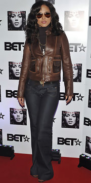 Alicia wears a dark brown leather jacket with her 70's rocker look for her CD launch in the UK.