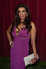 Actress Shobna Gulati styled her long hair in full glamourous curls for the 2012 British Soap Awards.