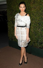 Camilla Belle donned a chic monochrome shawl-collar off-the-shoulder dress by Prabal Gurung for the Decades of Glamour Oscar party.