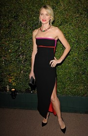 Naomi Watts exuded sexy elegance at the Decades of Glamour Oscar party in a strapless black Altuzarra dress with red and purple trim and a thigh-high slit.