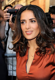 To try Salma Hayek's nude lip look, choose a shade or two darker than your natural lip color. When selecting a finish, something sheer will make the effect look even more natural and if you'd like, add just a touch of gloss for a little more dimension and shine. A great product option is Clinique Chubby Stick Moisturizing Lip Color Balm.