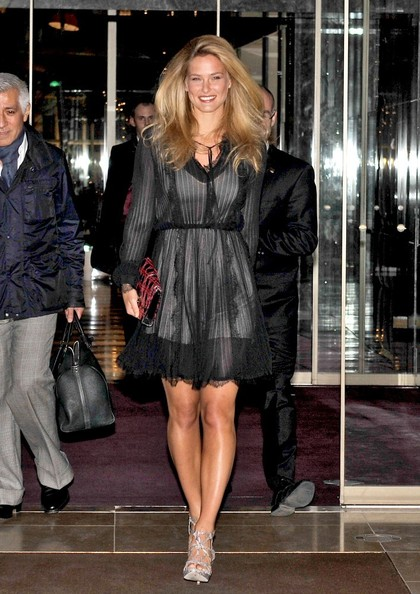 Bar Refaeli topped off her cocktail dress with strappy sandals.
