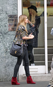 Fearne paired her suede ankle boots with a studded leather shoulder bag.