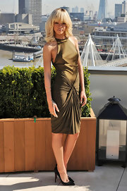 Rihanna arrived at a photocall for 'Battleship' wearing a silky olive dress and sexy black stilettos.