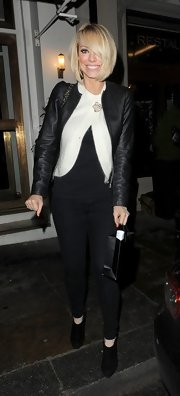 Liz Mcclarnon paired this sleek black leather jacket with a white cardigan and black pants for a cool black and white look.