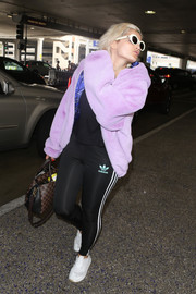 Bebe Rexha teamed her hoodie with black Adidas leggings.