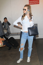 For her arm candy, Behati Prinsloo picked an elegant black leather tote by Balenciaga.