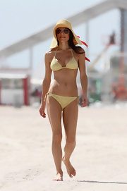 Bethenny Frankel flaunted her figure in a pale yellow string bikini.