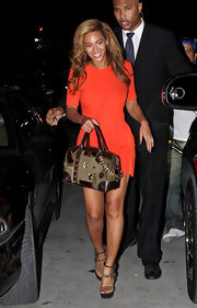Beyonce carried a brown and khaki handbag while attending a party for Jay-Z's book 'Decoded.'