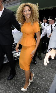 Beyonce wore a vibrant tangerine day dress with an adorable peplum while shopping at Harrod's in London.