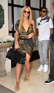Beyonce wore knockout Flesh Fish-bone platform sandals with intricate gold T-bars out to lunch.