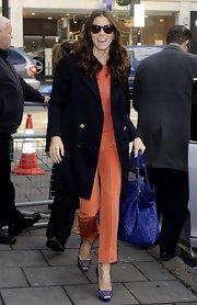 Jessica Biel was spotted out and about town in chic fall colors. The starlet opted for vibrant footwear, wearing cobalt blue strappy sandals.