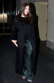 Jessica Biel looked sophisticated in a fitted black evening cot, which revealed a pair of teal satin slacks.