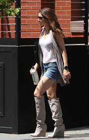 "Jessica sported a pair of canvas knee-high ""Jessica"" wedge boots in a sandy hue with rolled denim shorts. The breathable material makes for a fabulous spring shoe."