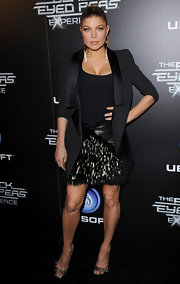 Fergie added sparkle to her style at the launch of the Black Eyed Peas Experience in a sparkly black sequined skirt.