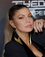 Fergie wore a creamy beige polish on her stiletto nails at the launch party for The Black Eye Peas Experience.