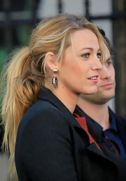 Blake Lively wore her lovely locks in a casually styled ponytail while filming scenes for 'Gossip Girl.'
