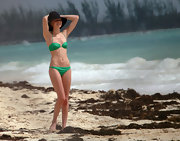 Kate showed off her tiny figure in a green bikini at the beach.