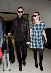 Michael Polish showed his edgier side with a burgundy motorcycle jacket while landing in LA with Kate Bosworth.