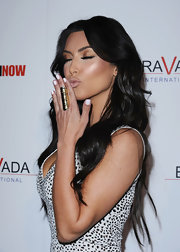 Kim blew a kiss and showed off a large hammered gold ring that almost covered her entire finger.