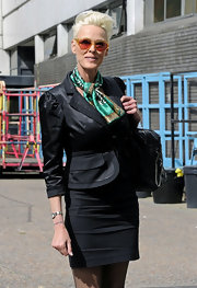 This short patterned neck scarf was the perfect pop of color on Brigitte Nielsen.
